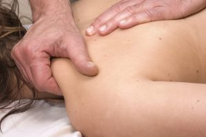 massage therapist doing deep tissue massage