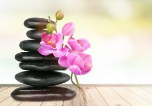 massage stones with a flower