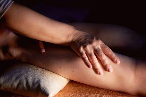 massage therapist working on clients legs