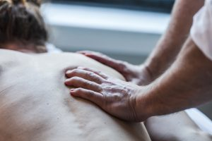 man getting deep tissue massage on back