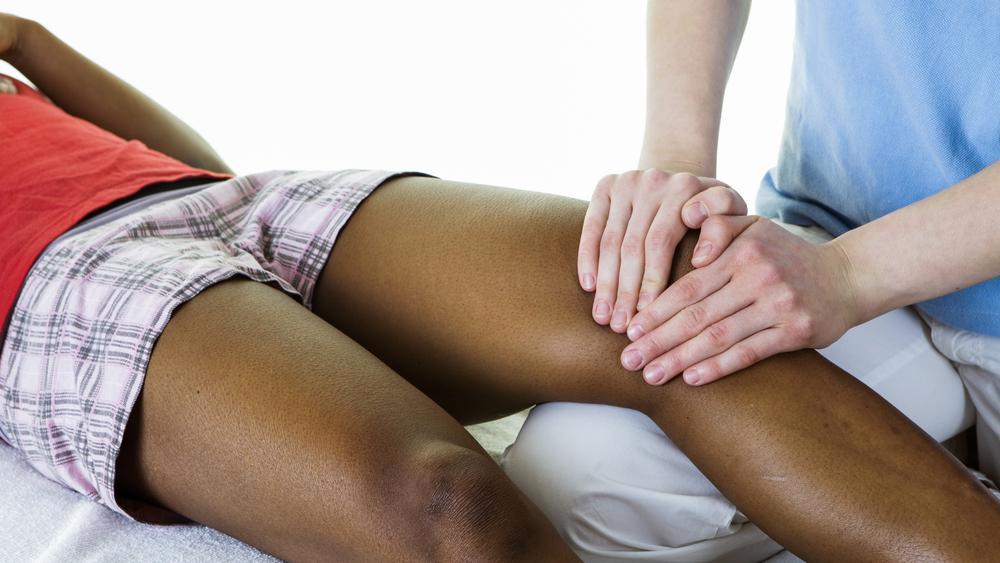 massage therapist working on a woman's leg