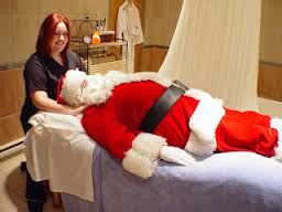 santa getting a table massage