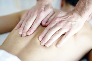 massage therapist giving a client a massage
