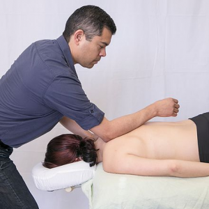 massage therapist doing deep tissue massage for a client