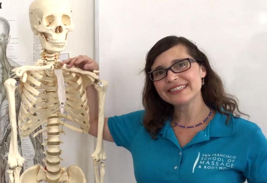 "Assistant Director, Sarah Partos, ham's it up with ""Bob"" the skeleton."